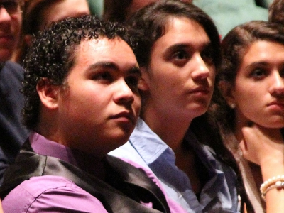 Image of students in the audience of Hayes Hall listening to a presenter on stage
