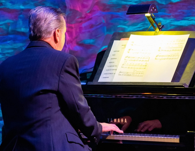 Image of members of the Naples Philharmonic Jazz Orchestra on stage during a performance of jazz music