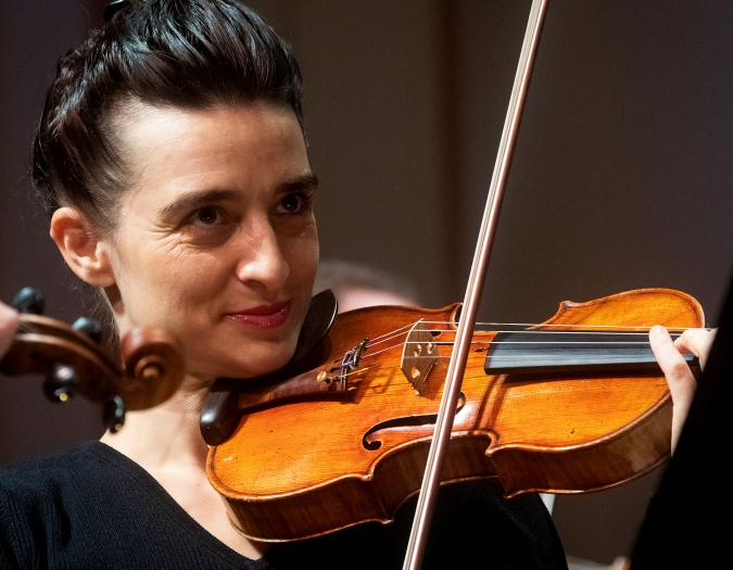 Image of Daniela Shtereva of the Naples Philharmonic on stage playing violin during a performance