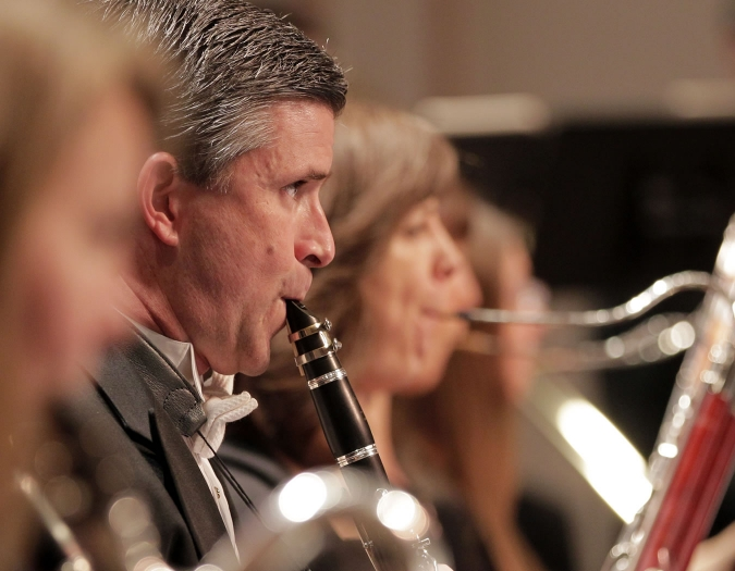Image of Paul Votapek and Kristen Sonneborn of the Naples Philharmonic on stage playing wind instruments during a performance