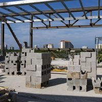 Stacks of concrete blocks are laid out in preparation for placement.