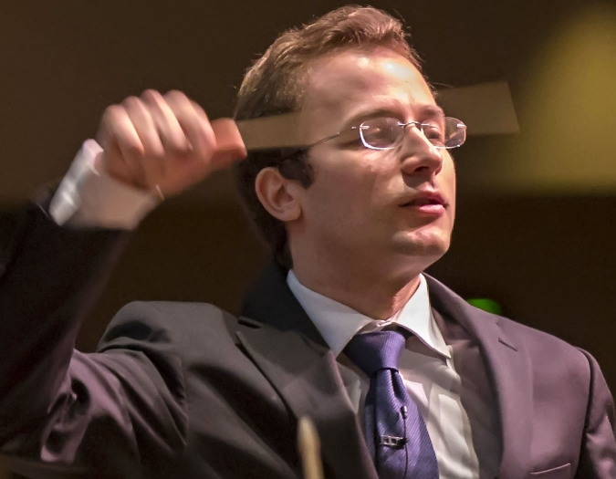 Image of Radu Paponiu, assistant conductor of the Naples Philharmonic on stage during a performance