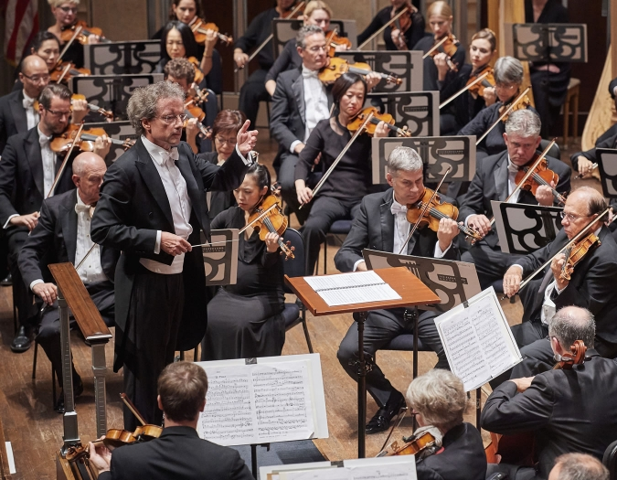 Image of Franz Welser-Möst, music director of the Cleveland Orchestra, on stage with the Cleveland Orchestra during performance