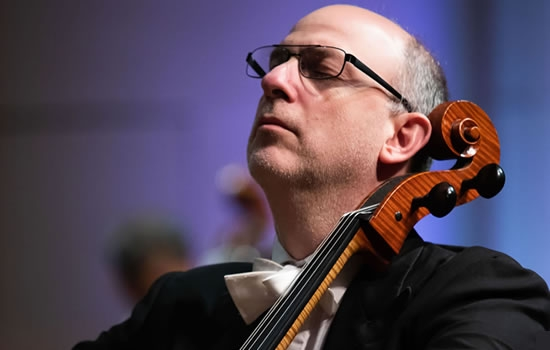 Image of Adam Stainksy of the Naples Philharmonic performing a solo during concert