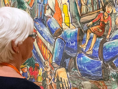 Image of patron viewing a work of art on the wall of a gallery at Artis—Naples