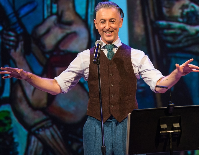 Image of Alan Cumming on stage during performance