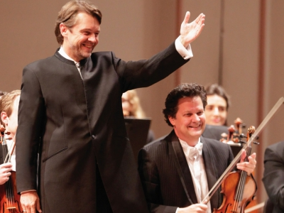 Image of Andrey Boreyko, conductor of the Naples Philharmonic on stage during a performance with Glenn Basham, concertmaster of the Naples Philharmonic