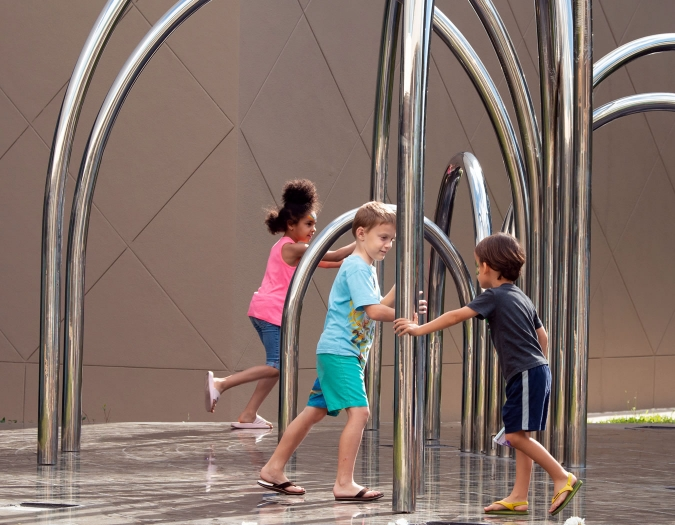 Image of children interacting with art during a Community Day event