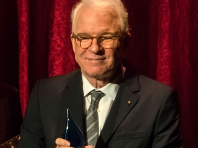 Image of actor and comedian Steve Martin accepting the Artis—Naples Award