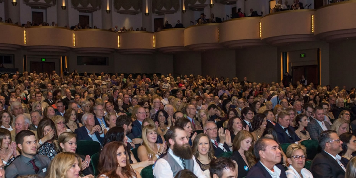 Image of the audience sitting in the seats of Hayes Hall as they get ready for the opening night film of the Naples International Film Festival