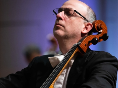 Image of Adam Satinksy of the Naples Philharmonic on stage during a performance