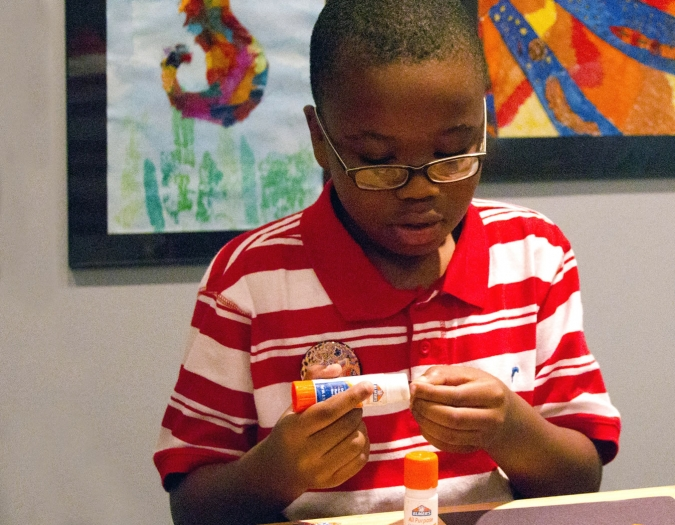Image of young boy making art during a Make and Take event