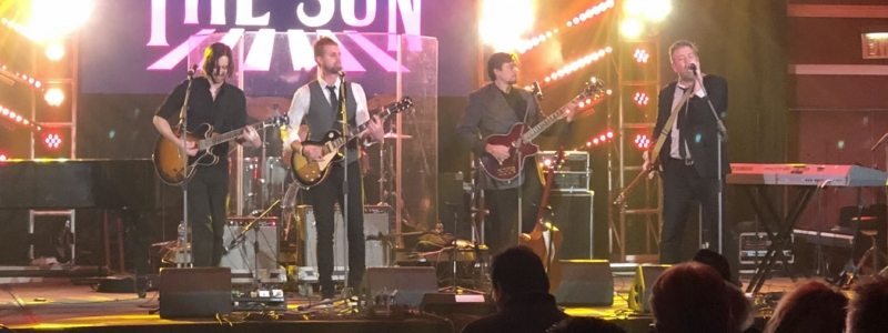 Image of Here Come the Sun on stage during performance