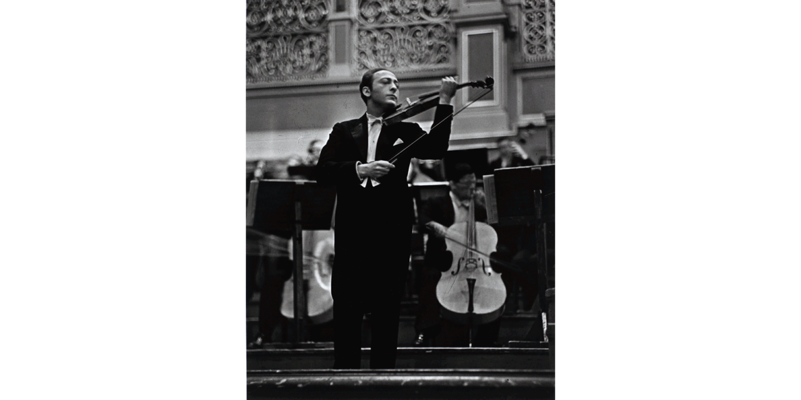 Alfred Eisenstaedt (German-born American, 1898-1995). Jascha Heifetz with the Berlin Philharmonic, 1933, 1933/printed 1979. Silver gelatin print, 21 x 17 1/8 inches. Artis—Naples, The Baker Museum. 1999.3.002. Bequest of Herbert and Ruth Abramson. © Th