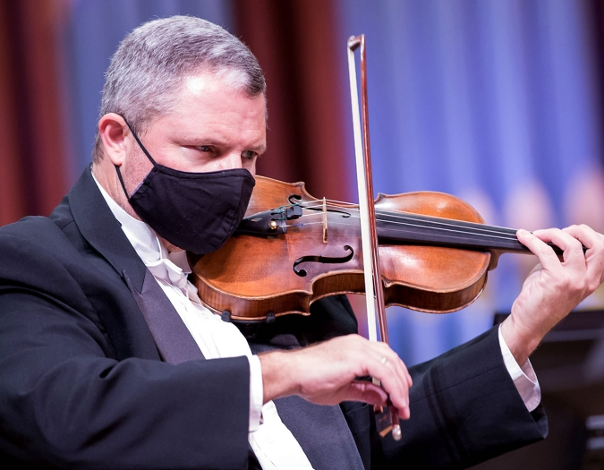 Image of David Mastrangelo Principal Second Violin  with the Naples Philharmonic on stage during a performance