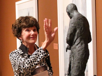 Image of a museum patron viewing a piece of art at The Baker Museum during an Art After Hours event