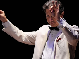 Image of Jack Everly, principal pops conductor of the Naples Philharmonic on stage during performance
