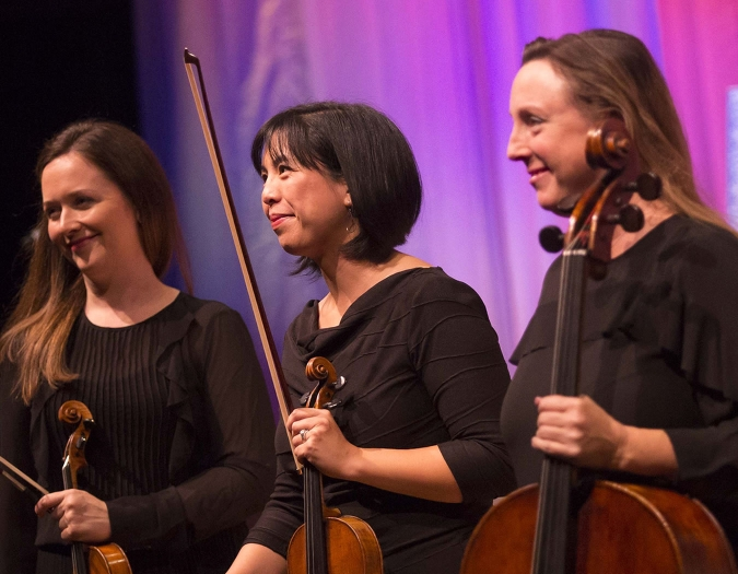 Image of Jennifer Kozbial Posadas, Marlena Chow Morgan and Susan Bergeron of the Naples Philharmonic on stage during a chamber music performance