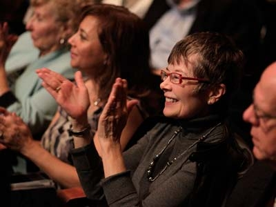 Image of audience members applauding a performance in Hayes Hall at Artis—Naples