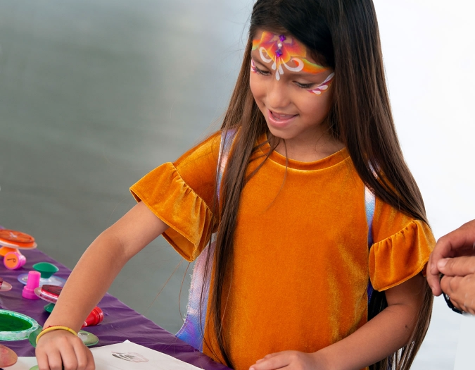 Image of child making art during a Community Day event