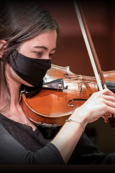 Image of a student musician performing with the Naples Philharmonic Youth Orchestra