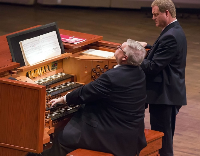 Image of James Cochran, Naples Philharmonic Chorus Conductor, and  Brice Gerlach, Naples Philharmonic Chorus Assistant Conductor and Accompanist, onstage during performance