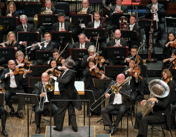 Image of members of the Chicago Symphony Orchestra on stage during performance
