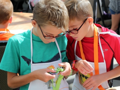 Image of young boys making art during a Make and Take event