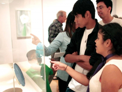 Image of museum patrons viewing pieces of art at The Baker Museum during an Art After Hours event