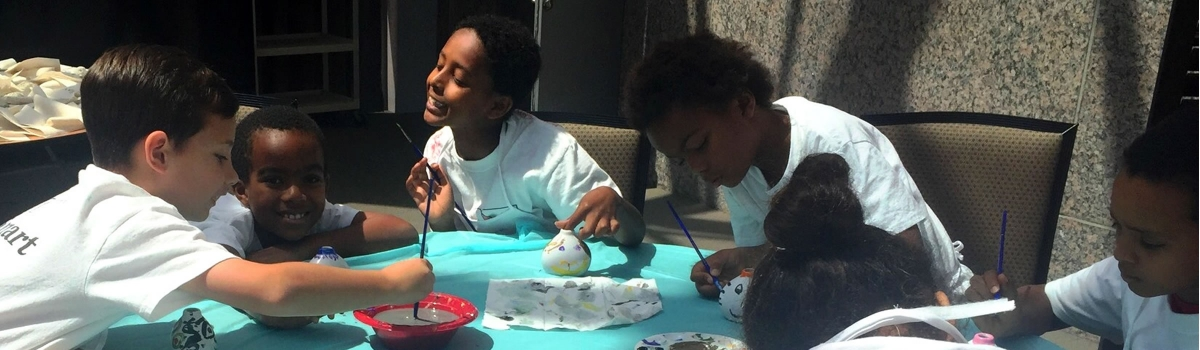Image of students making art at the Artsmart Summer Camp