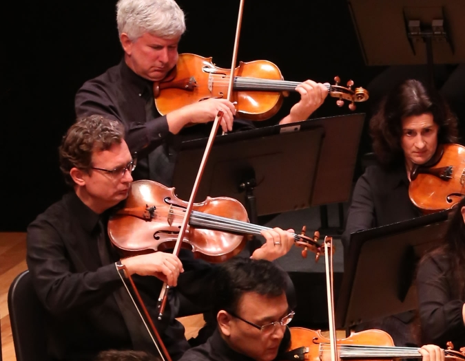 Image of James Griffith and Glenn Loontjens of the Naples Philharmonic on stage playing viola during a performance