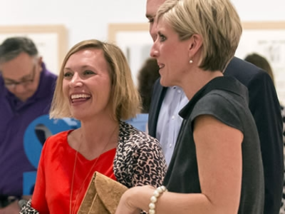 Image of Tiffany Heck, Vice President of Development, socializing with patrons at a pre-performance event at Artis—Naples