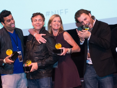 Image of award recipients of the Naples International Film Festival holding their awards and posing for the camera in celebration