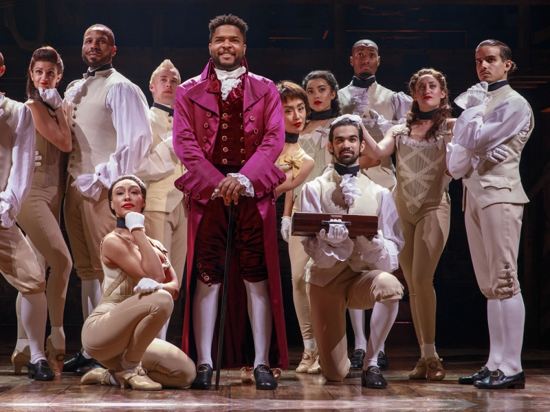 Image of the cast of the Broadway production Hamilton during performance