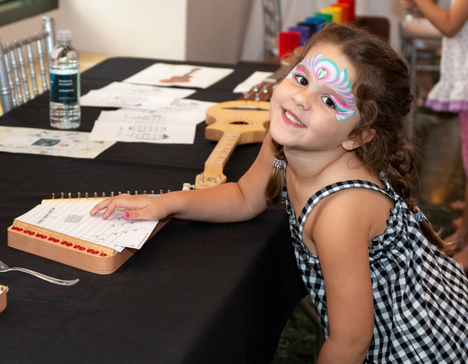 Image of a child making art during a Community Day event
