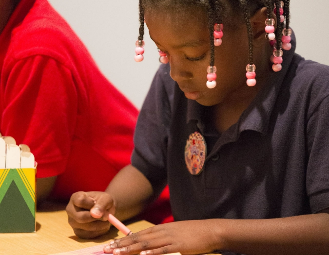 Image of young girl making art during a Make and Take event