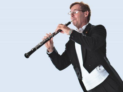 Image of artistic interpretation of a member of the Naples Philharmonic in musical celebration with wind instruments, as part of the Magic Carpet concert series