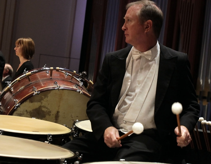 Image of John Evans of the Naples Philharmonic on stage playing Timpani during a performance