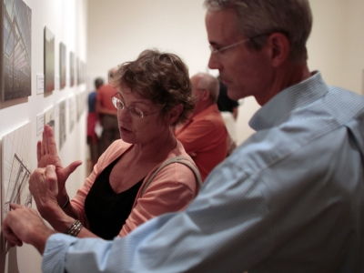 Image of museum patrons viewing pieces of art on the walls of The Baker Museum during an Art After Hours event