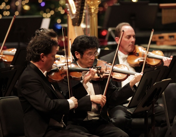 Image of members of the Naples Philharmonic during holiday performance