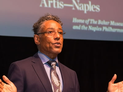 Image of actor Giancarlo Esposito speaking to the audience after accepting the Artis—Naples Award at the Naples International Film Festival