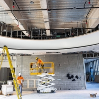 Construction crew members work on the Signature Event Space in The Baker Museum expansion.