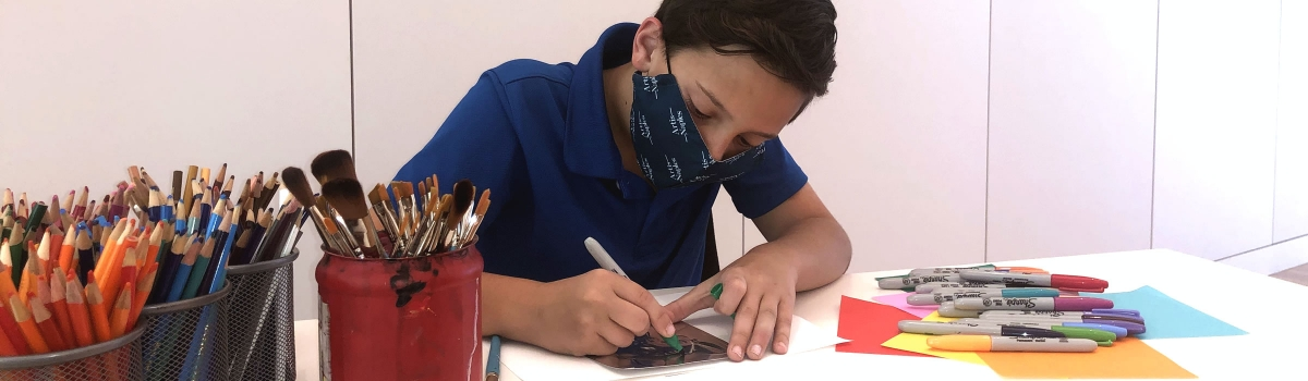 Image of student creating art during an educational event at Artis—Naples