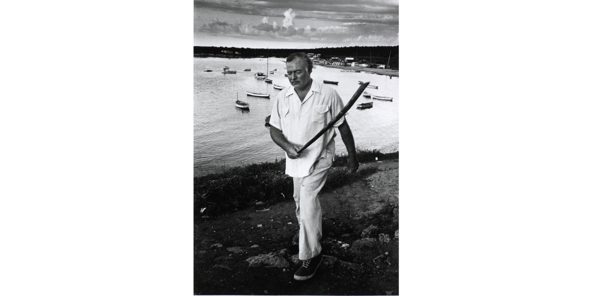 Alfred Eisenstaedt (German-born American, 1898-1995). Ernest Hemingway Walking in Cojimar Harbor, 1952/printed later. Silver gelatin print, 21 x 17 1/8 inches. Artis—Naples, The Baker Museum. 1999.3.001. Bequest of Herbert and Ruth Abramson. © The LIFE