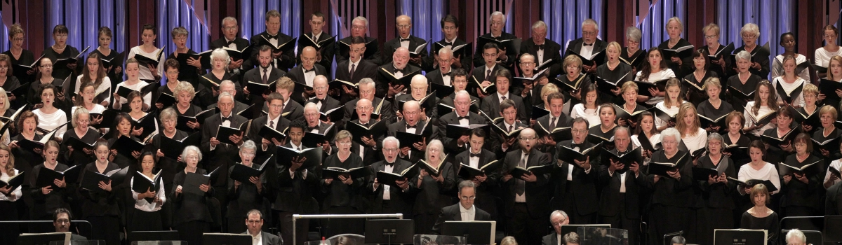 Image of the Naples Philharmonic Chorus on stage during a performance with the Naples Philharmonic
