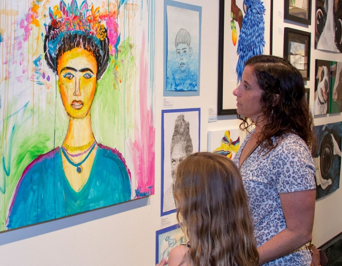 Image of mother and daughter looking at art during a Community Day event
