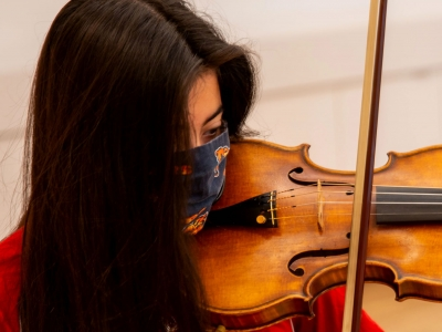 Image of a student musician performing with the Naples Philharmonic Youth Ensembles